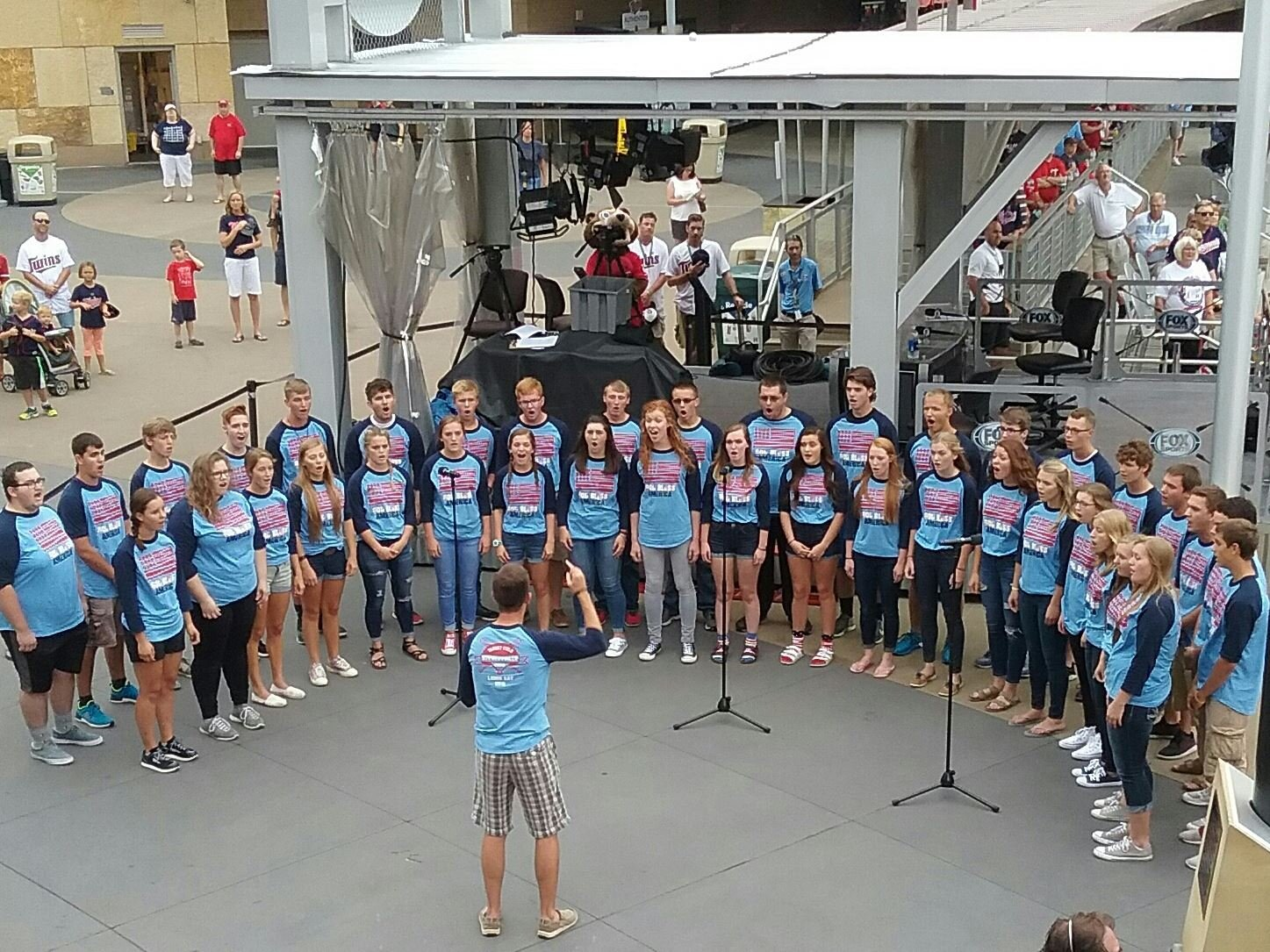 The Stewartville High School Choir sings at Monday's Twins game.