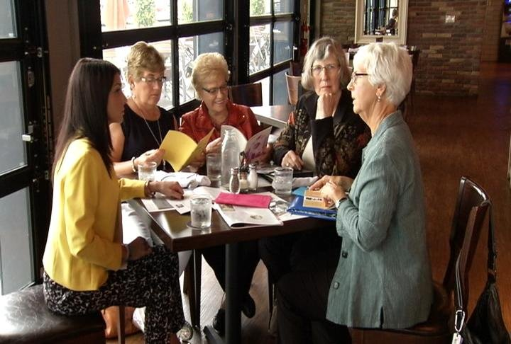 Reporter Alanna Martella sits with (from left) Carole Whitfield Gordon, Mary Kennedy Price, Charlotte Hostert Carey, and Kathy Shaefer Dale and chats about their days at Saint Marys Nursing School.