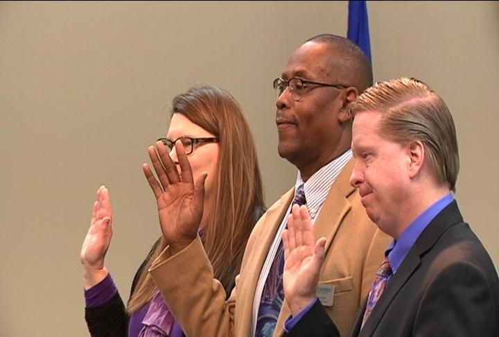 Deborah Seelinger, Don Barlow, and Mark Schleusner are sworn in at Tuesday night's RPS School Board Meeting.