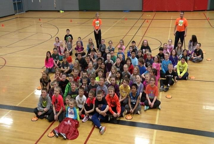 Third-graders at St. Charles Elementary School form a heart shape for a photo after taking part in Wednesday's Jump Rope For Heart event.