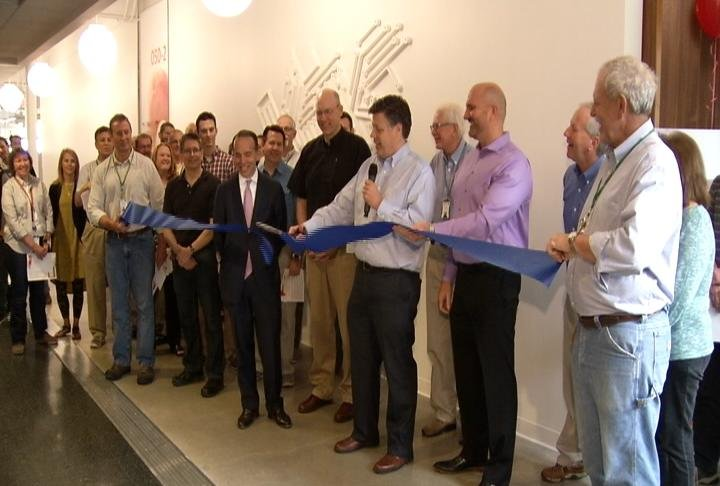 Senior Location Executive Tory Johnson cuts the ribbon for the agile workspace at IBM Rochester on Wednesday morning.