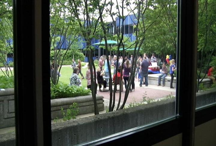 IBM workers mingle together in courtyard at new agile workspace.