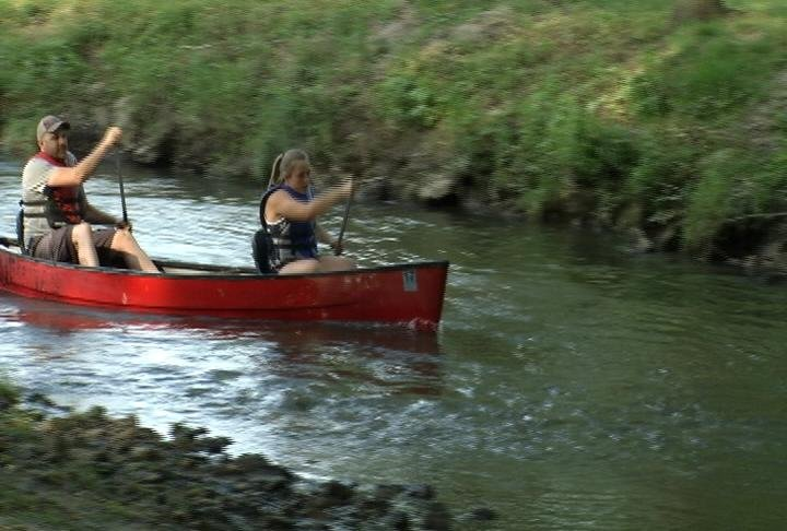 Izzy Riley and Casey Voight were in the lead from the start in this year's canoe race at the Pine Island Cheese Festival. The duo was trying to defend their crown.