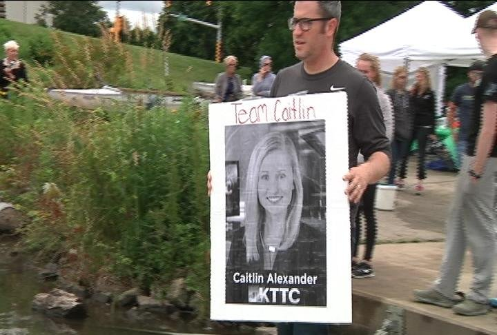 "Our sister station KTTC's Caitlin Alexander's husband, Ian Roth, carries a ""Team Caitlin"" sign at Sunday's Celebrity Regatta."