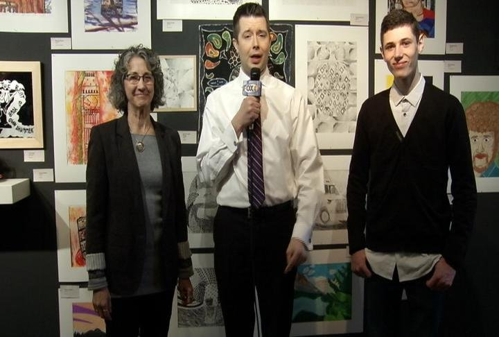 "Lanesboro Arts gallery director, Robbie Brokken & Lanesboro High student, Andrew Darling, discuss the ""Juried High School Art Show"" with Nicholas Quallich."